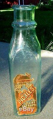 Large antique aqua glass cathedral pickle bottle with label