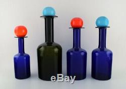 Otto Brauer for Holmegaard. A collection of four large vases / bottles